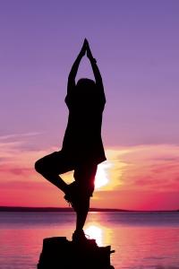 little-boy-doing-yoga-poses-at-sunset--1438823-1-m